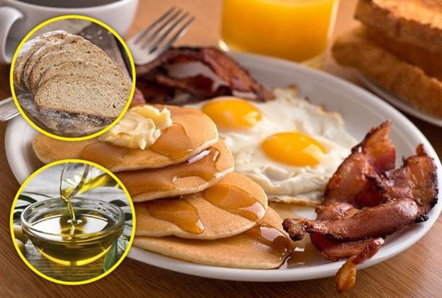 Ăn bánh mì với dầu ô liu vào bữa sáng